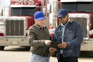 truckers reviewing a tablet